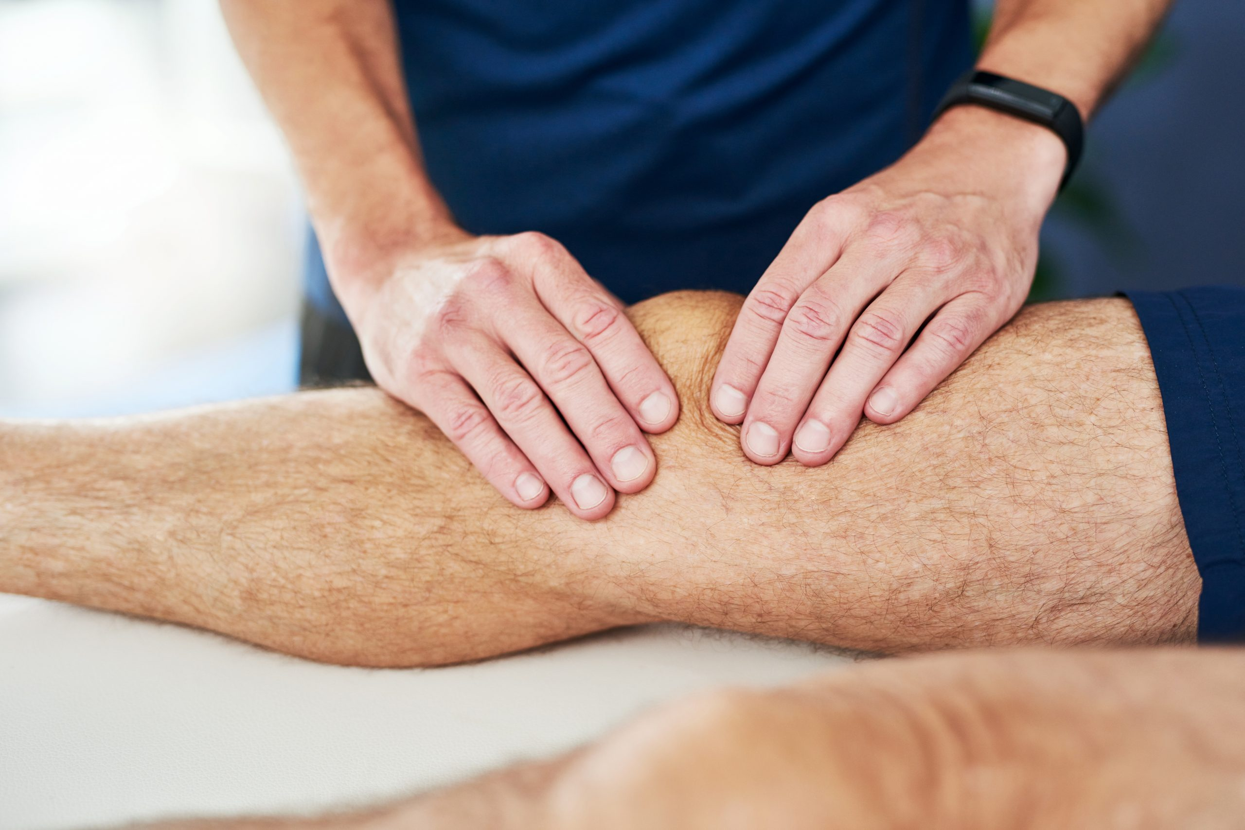 Cropped shot of an unrecognizable male physiotherapist massaging his patient's knee